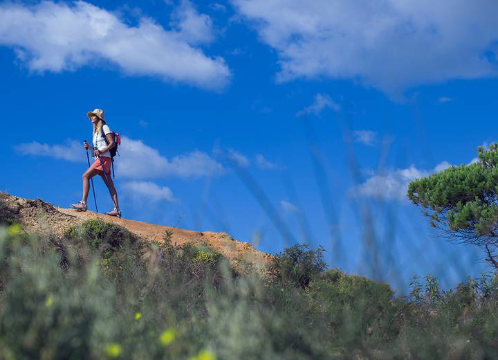 Woman hiking in the forest that surrounds Ombria