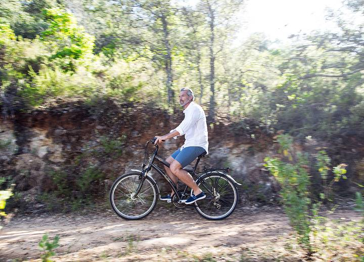 Man riding a bike in nature, exploring the surrounds of Ombria Resort