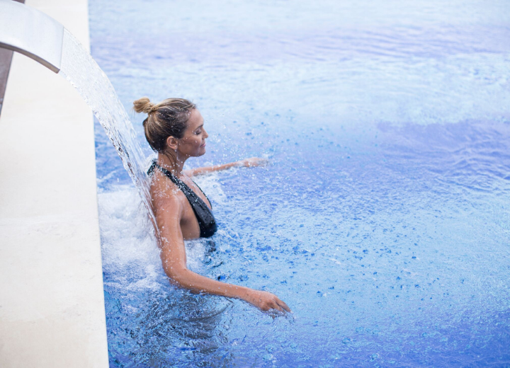 A lady in the swimming pool of Ombria Resort Spa